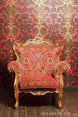 Vintage Chair With Gold Accents Beside Wall Royalty Free Stock Photos - Image: 15690678