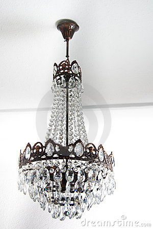 Vintage chandelier hanging on a white roof