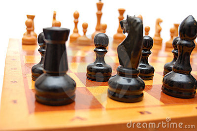 Vintage chessmen on chess board