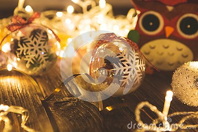 Vintage Christmas background with christmas baubles on wooden background over christmas lights Stock Photo