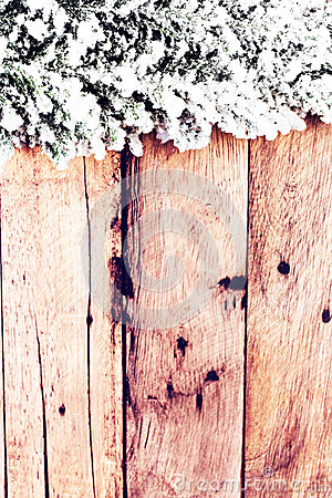 Vintage Christmas Card with Fir tree covered with snow on wooden