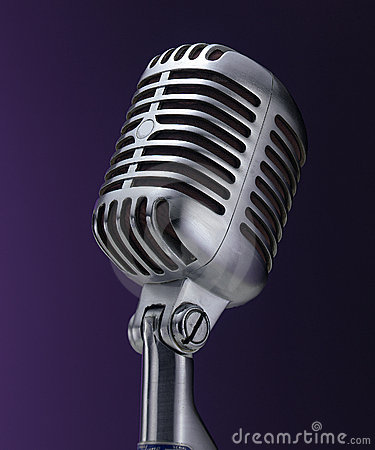 Vintage chrome microphone on purple