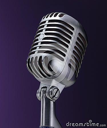 Vintage chrome microphone on purple
