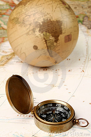 Vintage compass and globe over map