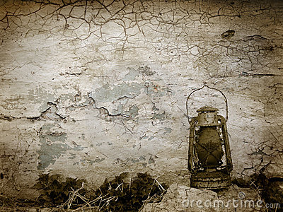 Vintage cracked wall with old lamp