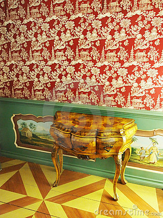Vintage davenport and wallpaper