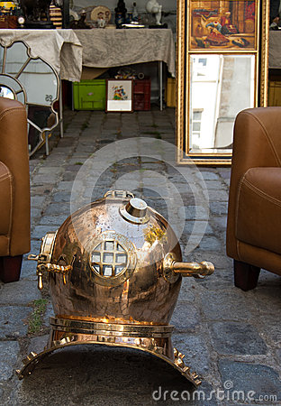 Vintage  diving helmet at flea market in Paris Editorial Photo