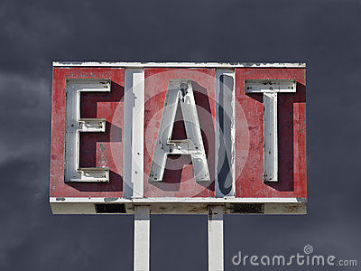 Vintage Eat Sign with Dark Thunderstorm Sky