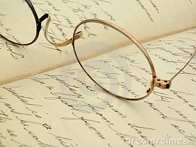 Vintage eyeglasses on a hand-written diary