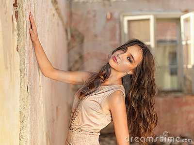 Vintage fashion portrait young woman old house