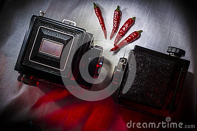 Vintage film equipment and red chili peppers