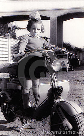 Vintage girl on old scooter