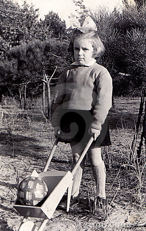 Vintage girl with wheelbarrow