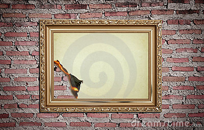 Vintage gold frame with burned on wall