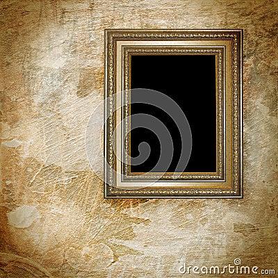 Vintage golden frame on grunge