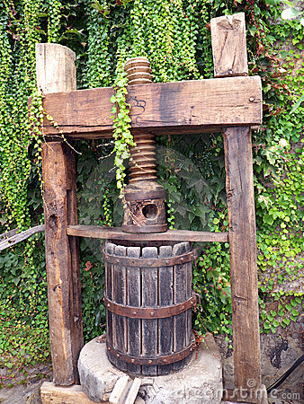 Vintage grape press for wine making