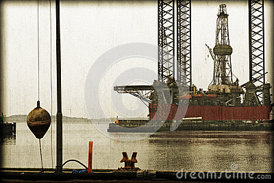 Vintage harbour and oil rig