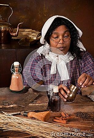 Vintage herb woman mixing