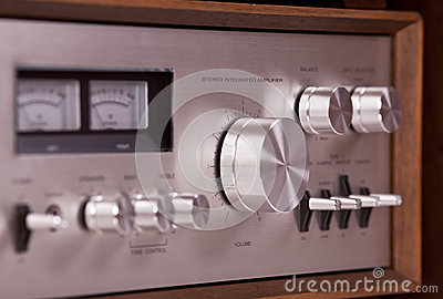 Vintage hi-fi Stereo Amplifier in wooden cabinet