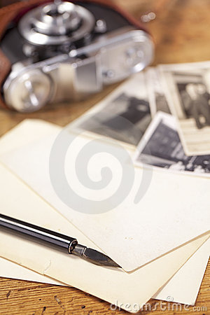 Vintage ink pen, old photos and camera