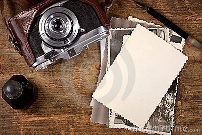Vintage ink and  pen, old photos and camera