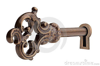 Vintage key in keyhole.