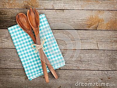 Vintage kitchen utensils over wooden table