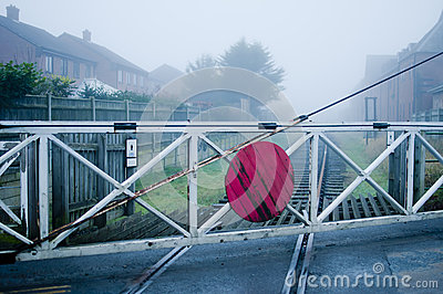 Vintage level crossing gate and railway line