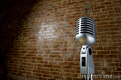 Vintage Microhone and brick wall