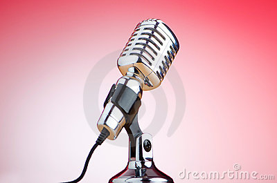 Vintage microphone against red background