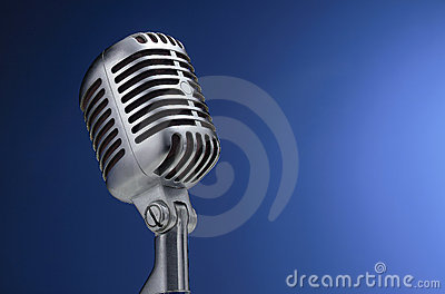 Vintage microphone on blue