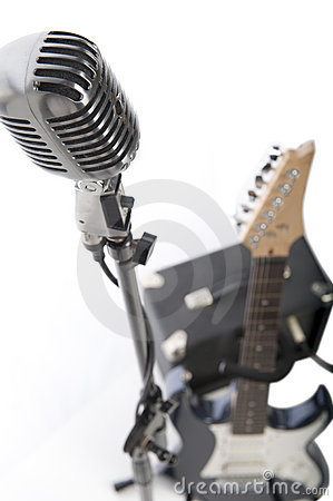 Vintage microphone, electric guitar and amp
