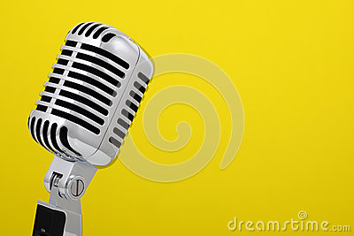 Vintage microphone isolated on yellow