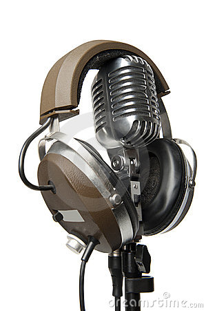 Vintage Microphone With Modern Headphones Stock