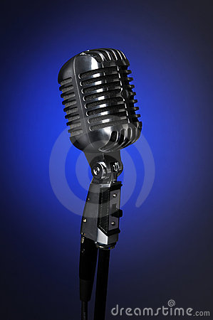Vintage Microphone Over Blue background
