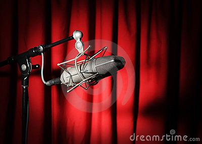 Vintage Microphone Over Red Curtain
