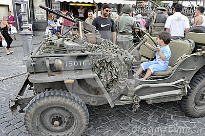 Vintage military jeep driven by a child. Editorial Stock Image