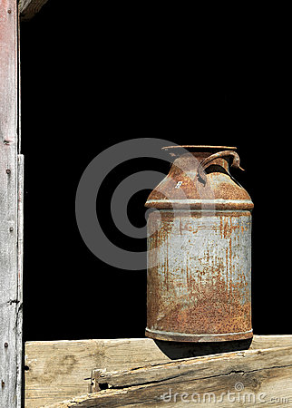 Vintage milk can and barn