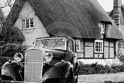 Vintage Motor Car outside a Thatched Cottage
