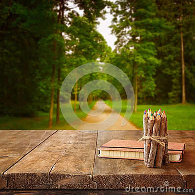 Free Vintage Notebook And Stack Of Wooden Colorful Pencils On Wooden Texture Table In Front Of Countryside Forest View Royalty Free Stock Photography - 59231477
