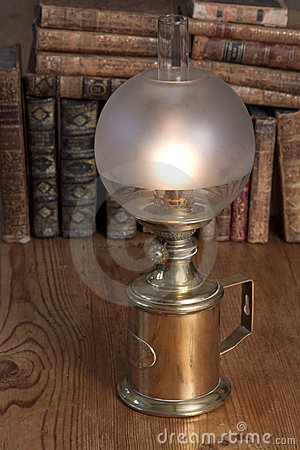 Free Vintage Oil Lamp With Books Stock Photos - 15634143