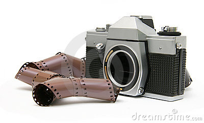 Vintage old film camera with film strip
