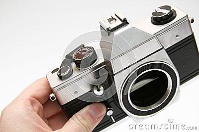 Vintage old film camera in hand