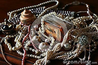 Vintage pearls treasure, old perfume bottle