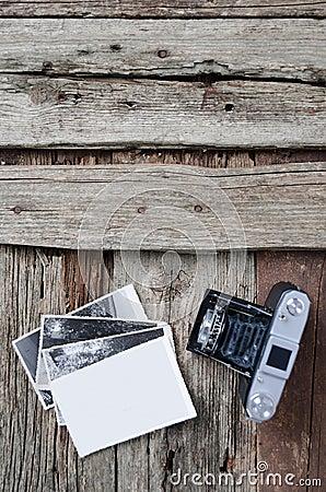 Vintage photo camera and photos