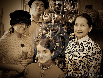 Vintage photo of Family near Christmas tree