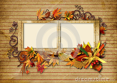 Vintage photo frame with autumn leaves and pencils