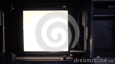 Vintage photographic film slide projector stock video footage