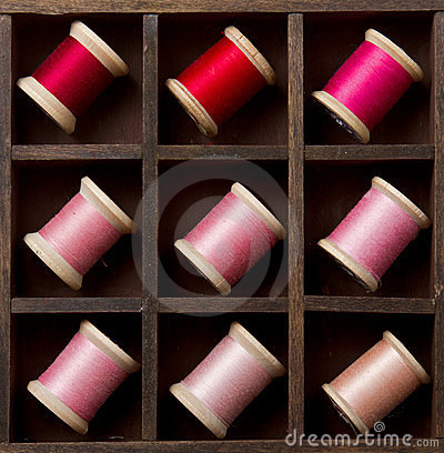 Vintage pink and red spools of thread