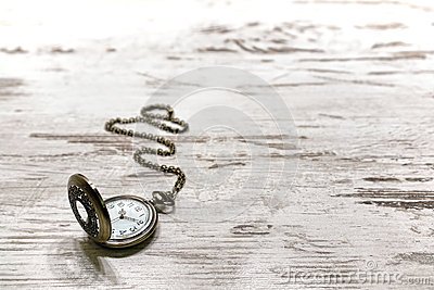 Vintage Pocket Watch on Old Aged Wood Background